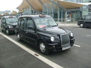 1200px-A_TX4_Taxi_at_Heathrow_Airport_Terminal_5
