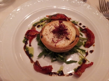 Carmelized onion and goat cheese tart on a bed of rocket. Almost too pretty to eat. Tiny, but richly delicious.