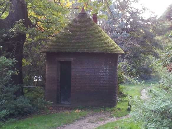 I saw this about halfway there.  No clue what it was or is; perhaps storage for maintenance items.  Love the mossy roof.