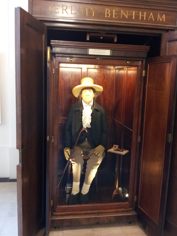 This is J.B.'s skeleton, dressed in his own clothing, with a wax mask of his face.  His head used to be between his feet, but now it's in the college vault.