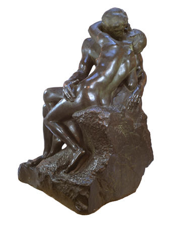 A bronze copy of Rodin's The Kiss.