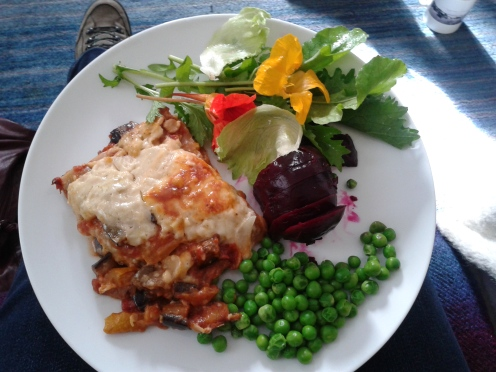 What we had for lunch from the allotment.  That's vegetarian lasagna, with spelt pasta and soy.  The flowers are nasturtiums--they are edible and kind of peppery, like watercress.  It was delicious.