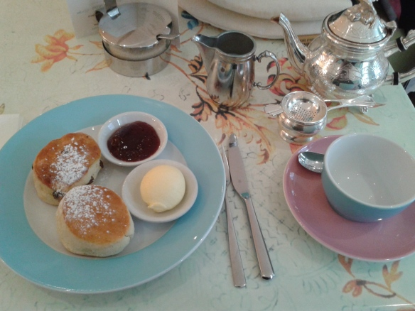 Look at the cute little teapot.  The scones and clotted cream and jam were very good, too.