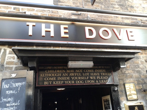 Here is a funny sign above a pub tucked into an alley we passed on the way.