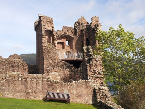 Urquhart Castle--Grant Tower from a small grassy area. You can see the hole where Clan Grant blew up the tower to keep the Jacobites from taking it.