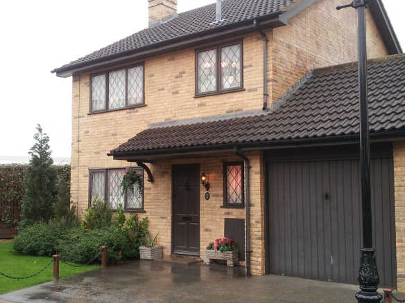Yep, just another rainy day at Number 4 Privet Drive; nothing to see here.  Certainly no wizards about.
